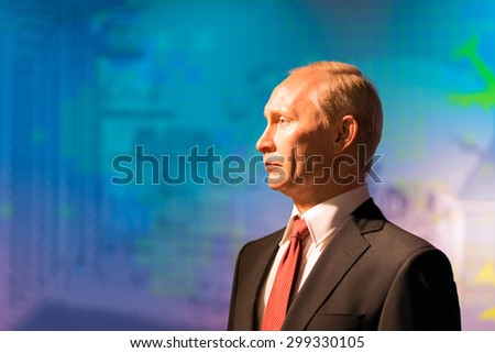 BANGKOK -JUL 22: A waxwork of Vladimir Putin on display at Madame Tussauds on July 22, 2015 in Bangkok, Thailand. Madame Tussauds' newest branch hosts waxworks of numerous stars and celebrities - stock photo