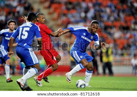 BANGKOK - JULY 24 :D.Drogba (R) in action during Coke Super Cup :Chelsea Asia Tour 2011 Thailand. TPL All Star between Chelsea at Rajamangla Stadium ,July 24, 2011 in Bangkok, Thailand. - stock photo