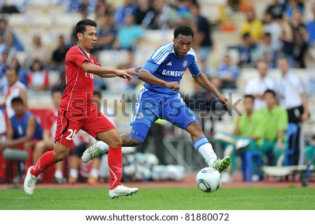 BANGKOK - JULY 24 :D.Sturridge (B) in action during Coke Super Cup :Chelsea Asia Tour 2011 Thailand. TPL All Star between Chelsea at Rajamangla Stadium ,July 24, 2011 in Bangkok, Thailand. - stock photo