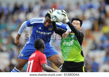 BANGKOK - JULY 24 :J.Mikel (B) in action during Coke Super Cup :Chelsea Asia Tour 2011 Thailand. TPL All Star between Chelsea at Rajamangla Stadium ,July 24, 2011 in Bangkok, Thailand.
