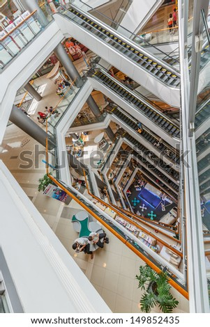 BANGKOK - JULY 25: People shopping in Central Chaengwattana on July 25, 2013. It is a Thai department store chain, owned by Central Group which has branches in Thailand and China. - stock photo