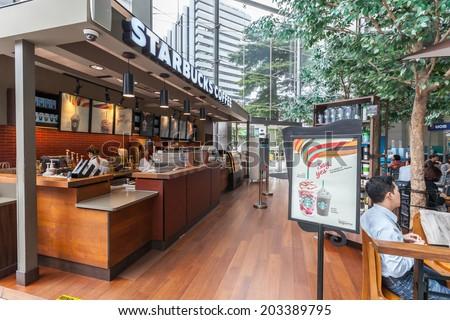 BANGKOK - July07: People visit Starbucks Coffee on july07, 2014 at bangkok city tower, bangkok. With 17,800 stores it is largest coffeehouse company worldwide. - stock photo