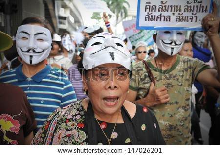 BANGKOK - JULY 21: Protesters hold an anti-government rally in Bangkok's shopping district on July 21, 2013 in Bangkok, Thailand. The protesters call for the government to be overthrown.
