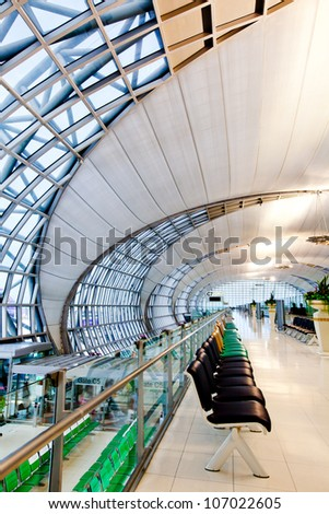 BANGKOK - JULY 1 :The main concourse of Suvarnabhumi Airport , designed by Helmut Jahn is the world's third largest single-building airport terminal on 1 July, 2012 in Bangkok ,Thailand. - stock photo