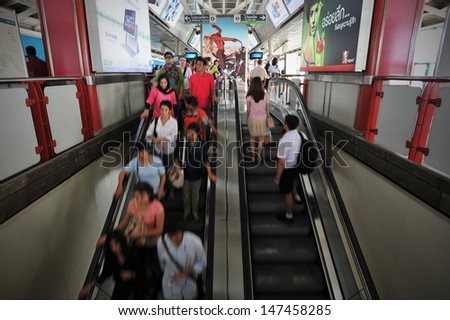 BANGKOK - JULY 17: Travellers pass through Siam Square BTS Skytrain station during rush hour on July 17, 2013 in Bangkok, Thailand. Launched in 1999, the BTS now has a daily ridership of 600,000.