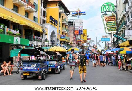 BANGKOK - July 27: Unidentified tourists walk along backpacker haven Khao San Road on July 27, 2014 in Bangkok, Thailand. Budget accommodation on Khao San Road starts from $8.5 or B250 per night.  - stock photo