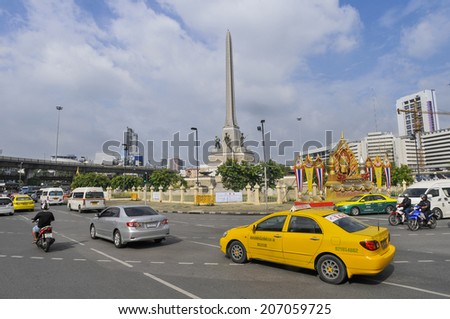 BANGKOK -July 01 : Victory Monument the large military monument in Bangkok on 01 July 2014. The monument was erected in June 1941 to commemorate the Thai victory in the Franco-Thai War. - stock photo