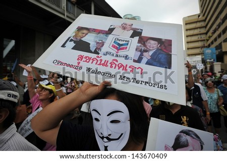 BANGKOK - JUNE 16: A protesters wearing a Guy Fawkes mask joins a large anti-government rally in Bangkok's shopping district on June 16, 2013 in Bangkok, Thailand.