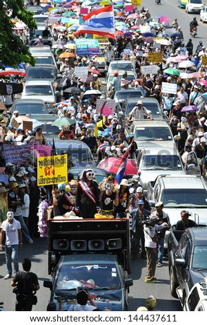 BANGKOK - JUNE 30: Anti-government protesters wearing masks rally in Bangkok's shopping district on June 30, 2013 in Bangkok, Thailand. The protesters are calling for the government to be overthrown.
