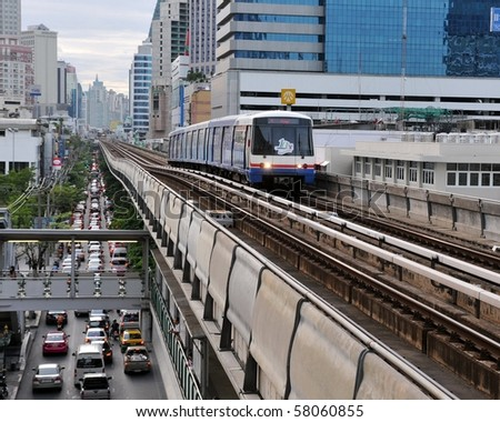 BANGKOK - JUNE 7: BTS Skytrain on elevated rail above Sukhumvit Road as the BTS network celebrates its 10th anniversary of operations in the Thai capital June 7, 2010 in Bangkok, Thailand. - stock photo