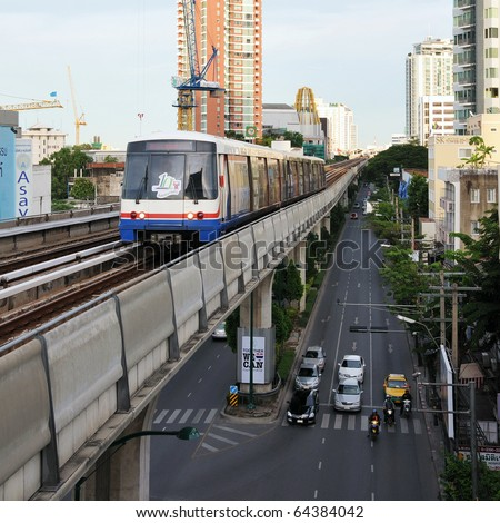 BANGKOK - JUNE 8: BTS Skytrain on elevated rail above Sukhumvit Road as the BTS network celebrates its 10th anniversary of operations in the Thai capital June 8, 2010 in Bangkok, Thailand. - stock photo