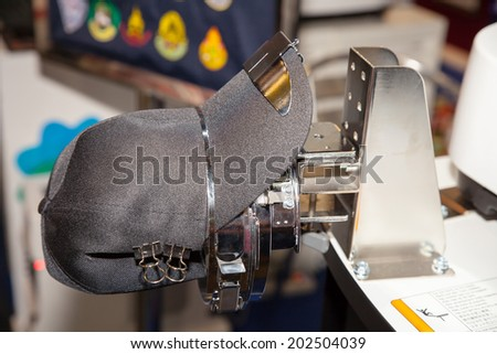 BANGKOK - JUNE 28 :Cap on embroidery machine at Garment Manufacturers Sourcing 2014 on June  28,2014 in BITEC ,Bangkok, Thailand. - stock photo