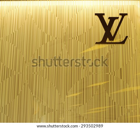 BANGKOK - JUNE 28, 2015: Louis Vuitton symbol on monogram wall at  shop in Siam Paragon Shopping mall, Thailand. LV is a French fashion house. LV has been named the world's most valuable luxury brand. - stock photo