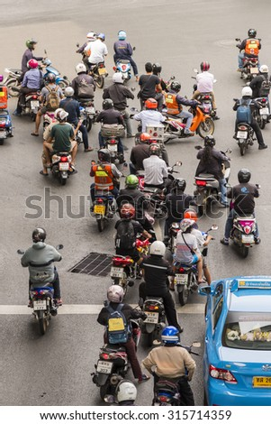 BANGKOK - JUNE 15: Motorcycles wait for a green light at a Bangkok intersection on June 15, 2015. Motorcycle sales in Thailand have increased by 13.8% since the previous year.