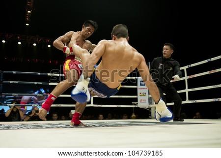 "BANGKOK - JUNE 9: Muay Thai Welterweight World Championship fight - Big Ben Ch. Praram 6 (Thailand) vs Fabio Pinca (France) at ""BATTLE FOR THE BELTS"" event on June 9, 2012 in Bangkok, Thailand - stock photo"