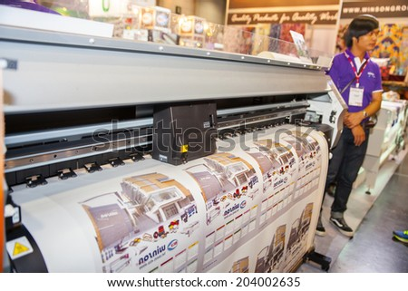 BANGKOK - JUNE 28 :Professional printing machine at Garment Manufacturers Sourcing 2014 on June 28,2014 in BITEC ,Bangkok, Thailand. - stock photo