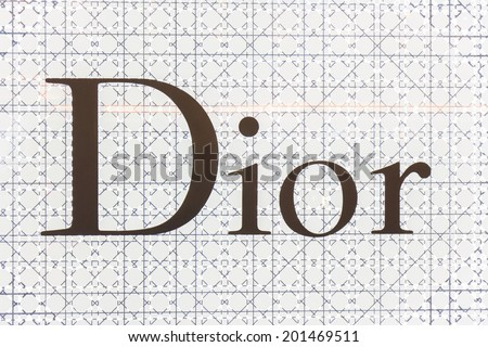 BANGKOK - JUNE 17: The sign of Dior at Dior store on Jun 17, 2014 in Suvarnabhumi  Airport, Thailand. It is a French company controlled and chaired by Bernard Arnault who also heads Louis Vuitton. - stock photo