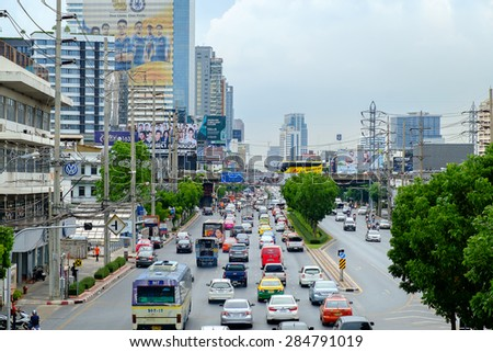 Bangkok  - June 3, 2015: Traffic moves slowly along a busy road on June 3, 2015 in Bangkok, Thailand. Annually an estimated 150,000 new cars join the already heavily congested streets of Bangkok. - stock photo