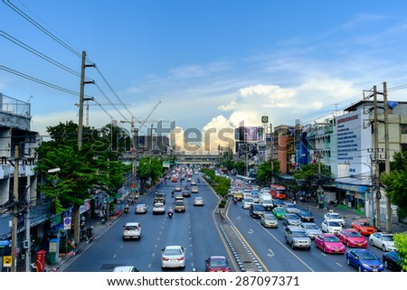 Bangkok - June 10, 2015: Traffic moves slowly along a busy road on June 10, 2015 in Bangkok, Thailand. Annually an estimated 150,000 new cars join the already heavily congested streets of Bangkok. - stock photo