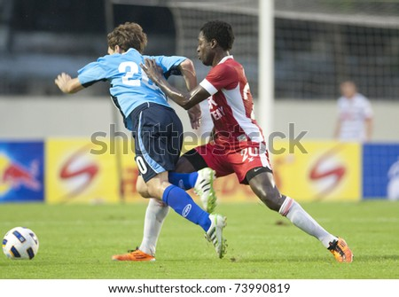 BANGKOK - MAR 26: M.Justin(B) and B.ajuwa in Thai Premier League (TPL) between BEC Tero vs Sriracha (Blue) on March 26, 2011 at Thep Hatsadin Stadium in Bangkok, China