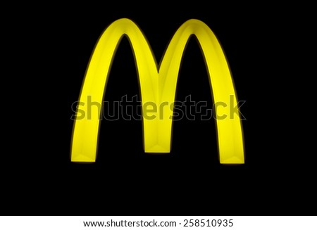 BANGKOK - 7 MAR: McDonalds sign with the famous M sign at a black board during evening. 7 March 2015, Thailand. McDonalds Corporation is the worlds largest chain of hamburger fast food restaurants - stock photo