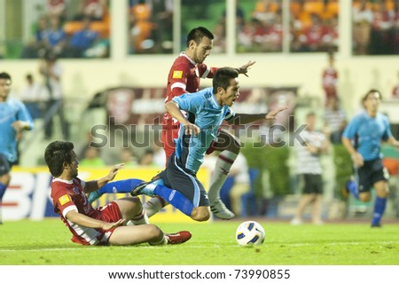 BANGKOK - MAR 26: S.Chaipakom(B) in Thai Premier League (TPL) between BEC Tero vs Sriracha (Blue) on March 26, 2011 at Thep Hatsadin Stadium in Bangkok, China - stock photo