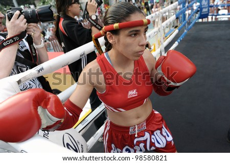 BANGKOK - MARCH 23: An unidentified female Muay Thai fighter warms up before a match in the World Amateur Muay Thai Championships at the National Stadium on March 23, 2012 in Bangkok, Thailand. - stock photo