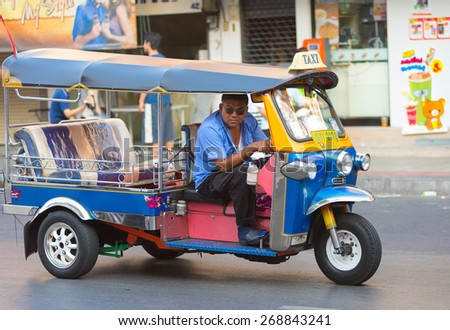 BANGKOK - MARCH 10, 2015: An unidentified tuktuk driver looks inquiringly into camera in Sam Sen Road. It is in the tourist area with plenty of budget hotels and guesthouses. - stock photo