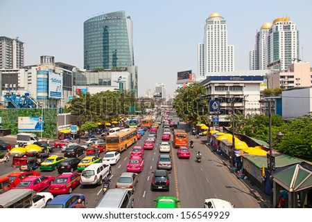 BANGKOK - MARCH 3: Daily traffic jam in the afternoon on March 3, 2012 in Bangkok, Thailand. Traffic jams remains constant problem in Bangkok despite rapid development of public transportation system. - stock photo