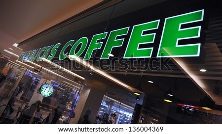BANGKOK - MARCH 31: Exterior view of a Starbucks store in the city centre on March 31, 2013 in Bangkok, Thailand. Starbucks is the world's largest coffeehouse with over 20,000 stores in 61 countries. - stock photo