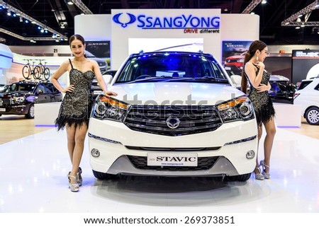 "BANGKOK - MARCH 24 : Female presenters model with SsangYong Stvic on display at The 36th Bangkok International Motor Show ""Art of Auto"" on March 24, 2015 in Bangkok, Thailand. - stock photo"
