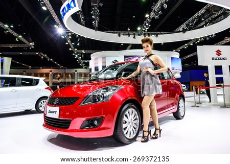 "BANGKOK - MARCH 24 : Female presenters model with Suzuki Swift on display at The 36th Bangkok International Motor Show ""Art of Auto"" on March 24, 2015 in Bangkok, Thailand. - stock photo"