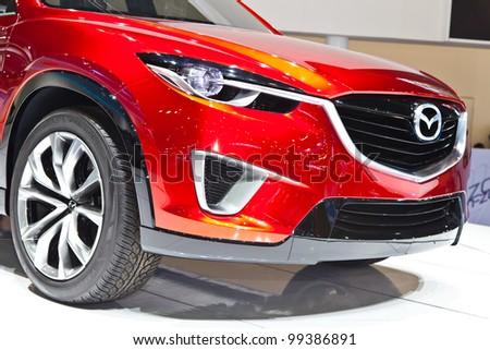 BANGKOK - MARCH 31 : Mazda car on display in Challenger Hall, Impact Muangthong Thani,The 33 rd Bangkok International Motor Show in Bangkok,Thailand on March 31, 2012. - stock photo