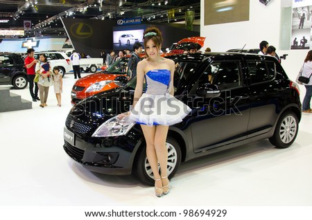 BANGKOK - MARCH 27: Suzuki Swift car with unidentified model on display at The 33th Bangkok International Motor Show  on March 27, 2012 in Bangkok, Thailand.