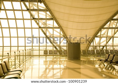BANGKOK - MARCH 22: The main concourse of Suvarnabhumi Airport, designed by Helmut Jahn is the world's third largest single-building airport terminal on March 22, 2012 in Bangkok, Thailand. - stock photo