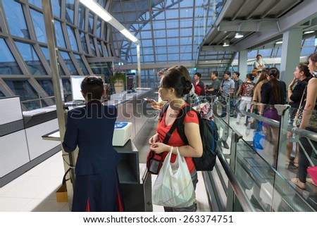 BANGKOK - MARCH 18; 2015: Unidentified air passengers register to board the flight of the Vietjet Air company. The Bangkok International Airport Suvarnabhumi is the sixth busiest airport in Asia. - stock photo