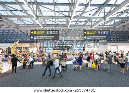 BANGKOK - MARCH 18; 2015: Unidentified air passengers walk in the departure area of the Bangkok International Airport Suvarnabhumi which is the sixth busiest airport in Asia. - stock photo