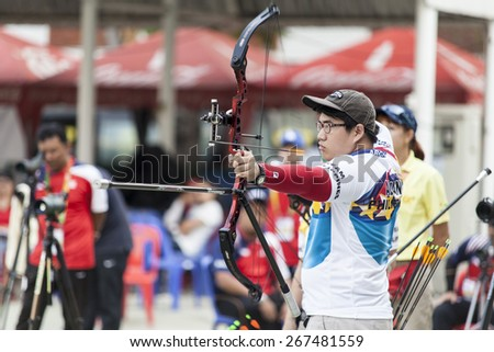 BANGKOK -MARCH 19 : Unidentified archers in a row and shootin 2015 Asia Cup-World Ranking Tournament (stage II) at Hua Mak Sports Complex on March 19, 2015 in Bangkok, Thailand.