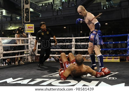BANGKOK - MARCH 22: Unidentified athletes compete in the World Amateur Muay Thai Championships at the National Stadium on March 22, 2012 in Bangkok, Thailand. - stock photo