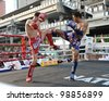 BANGKOK - MARCH 20: Unidentified Muay Thai fighters compete in the World Amateur Muay Thai Championships at the National Stadium on March 20, 2012 in Bangkok, Thailand. - stock photo