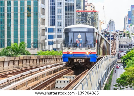 BANGKOK - MAY 19:  BTS Skytrain on elevated rails in Asoke district on May 19, 2013 in Bangkok, Thailand. It's the fist electric train system in thailand. - stock photo