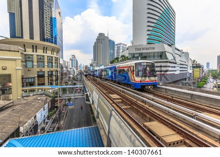 BANGKOK - MAY 19: BTS Skytrain on elevated rails in Asoke district on May 19, 2013 in Bangkok, Thailand. It's the fist electric train system in thailand.