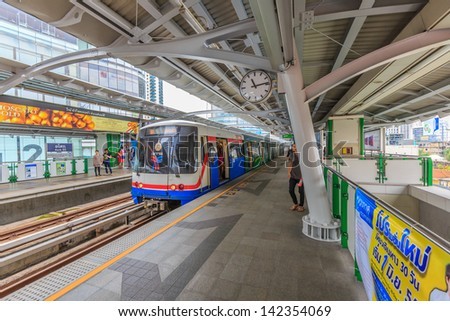 BANGKOK - MAY19: BTS Skytrain on elevated rails in Asoke district on May 19,13 in Bangkok. It's the fist electric train system in thailand. Each train can carry over 1,000 passengers. - stock photo