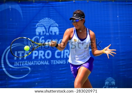 BANGKOK, MAY 30 : Bunyawi Thamchaiwat (Thai) action in Chang ITF Pro Circuit International Tennis Federation 2015 at Rama Gardens Hotel on May 30, 2015 in Bangkok, Thailand. She won in the final match - stock photo