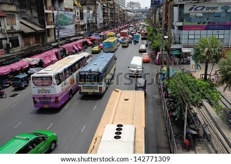 BANGKOK - MAY 30: Daily traffic jam in the afternoon on May 30, 2013 in Bangkok, Thailand. Traffic jams remains constant problem in Bangkok despite rapid development of public transportation system. - stock photo