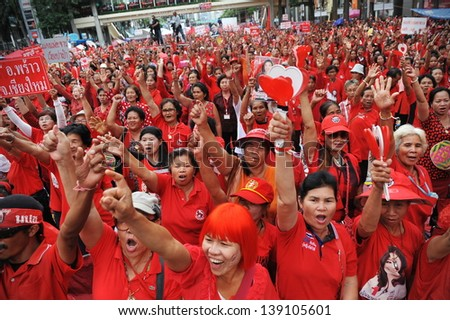 BANGKOK - MAY 19: Protesters attend a large red shirt rally on May 19, 2013 in Bangkok, Thailand. Red shirts gathered to mark the 3rd anniversary of a bloody crackdown on anti-government protests. - stock photo
