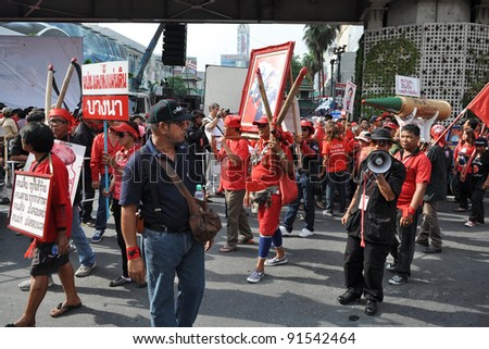 BANGKOK - MAY 19: Red-shirt protesters at a large rally at Ratchaprasong on May 19, 2011 in Bangkok, Thailand. The protesters gathered to mark one year since 91 people died in clashes in Bangkok. - stock photo
