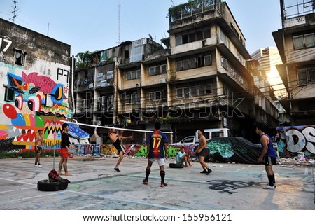 BANGKOK - MAY 27: Takraw players hold an informal street match on derelict land on May 27, 2013 in Bangkok, Thailand. Takraw or Kick Volleyball is a popular activity with youth in the Thai capital. - stock photo