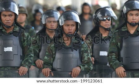 BANGKOK - MAY 31: Thai soldiers in riot gear secure a shopping district in preventing anti-coup protests on May 31, 2014 in Bangkok, Thailand. Thailand is experiencing its 19th military coup. - stock photo