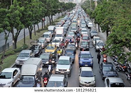 BANGKOK - MAY 9: Traffic moves slowly along a busy city centre road on May 9, 2012 in Bangkok, Thailand. Annually an estimated 150,000 new cars join the heavily congested roads of Bangkok - stock photo
